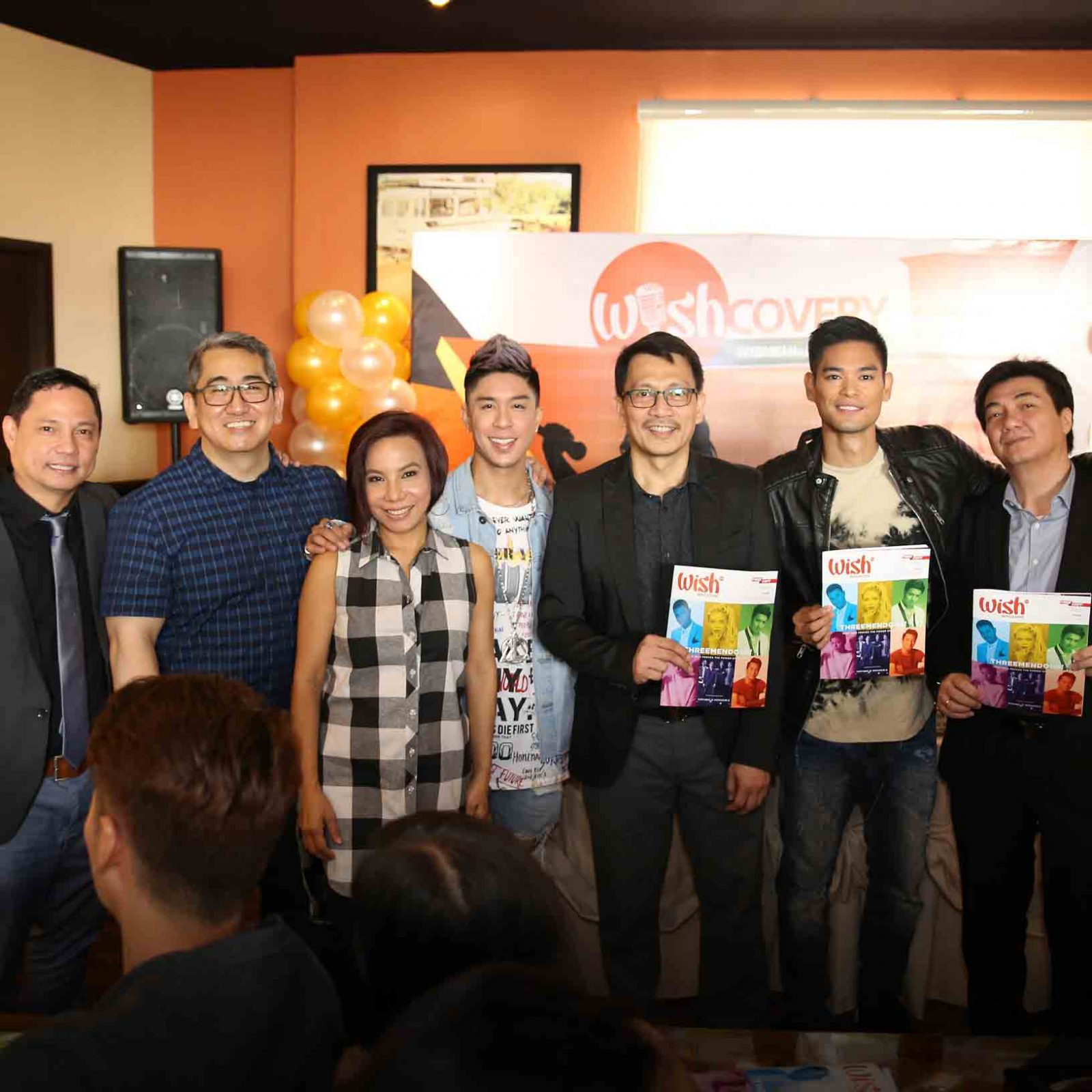 (L-R) BMPI VP for TV and Marketing Mr. Jay Eusebio, Wishcovery reactors Mrs. Jungee Marcelo and Teacher Annie Quintos of The Company, Wishcovery host Kris Lawrence, BMPI President/CEO Kuya Daniel Razon, Wishcovery reactor JayR, and BMPI VP for Radio Mr. Bong Etorma pose for a snapshot with the teaser of the soon-to-be-launched Wish 107.5 magazine.   (Photo courtesy of Photoville International)