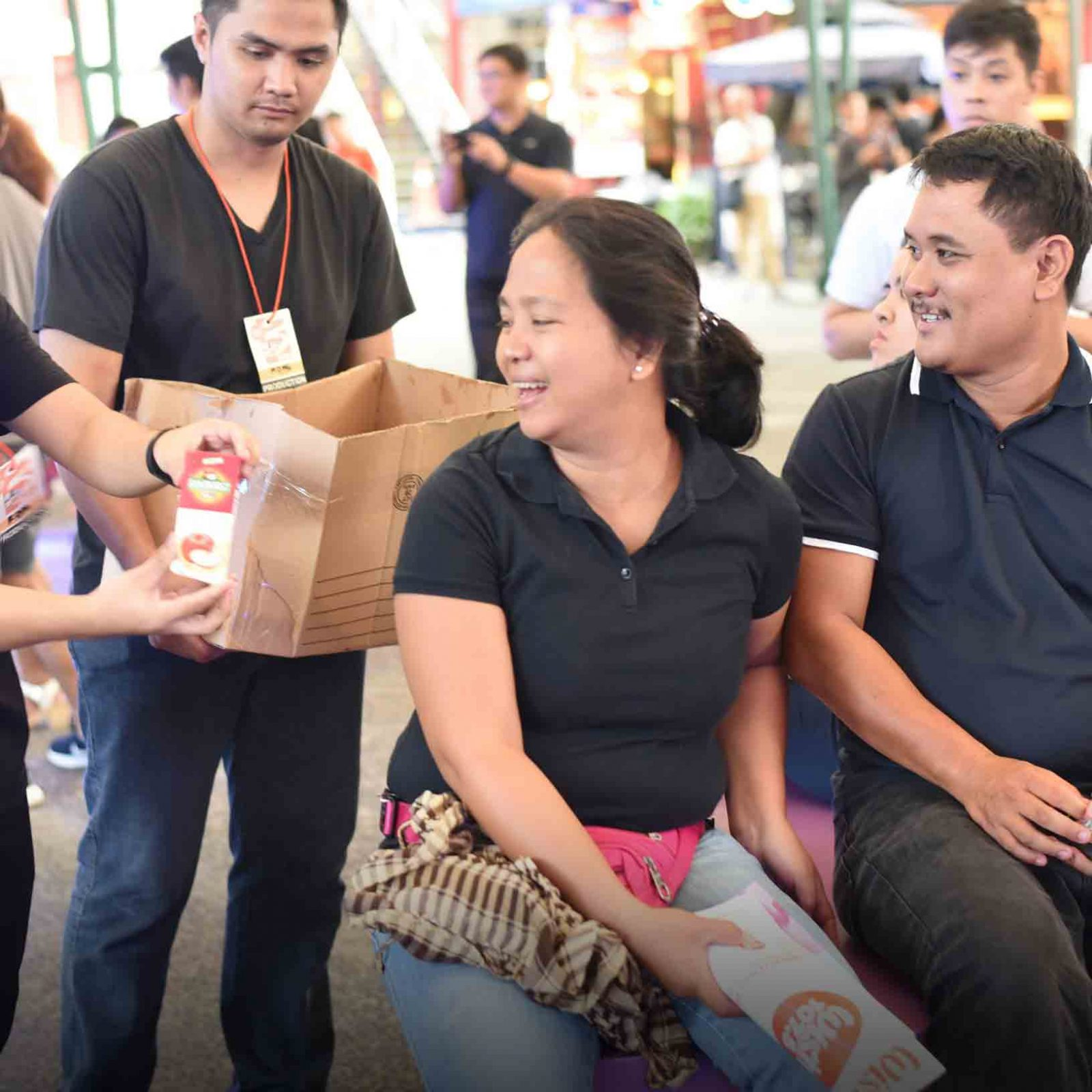 The Wish 107.5 crew offers free refreshments to Wishers as they listen to different OPM acts during the THREEmendous Thanks party held at the Eastwood Central Plaza.   (Photo courtesy of Photoville International)